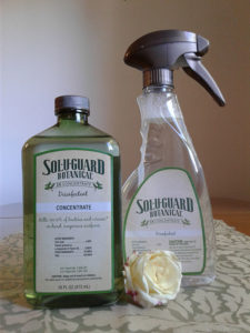 Photo of Sol-U-Guard Botanical Disinfectant Concentrate and Mixing Spray Bottle. EnhancedLivingForToday.com